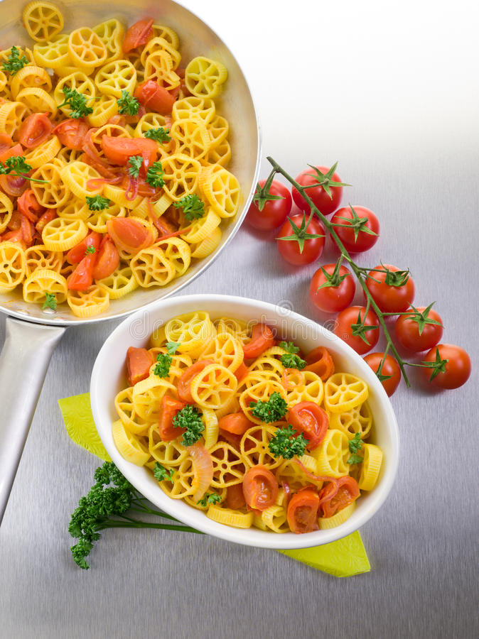 Download Pasta with fresh tomatoes stock image. Image of recipe - 23875189