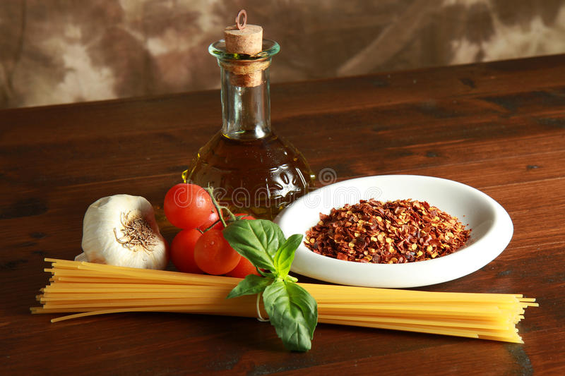 Download Pasta Garlic Olive Oil And Red Chili Pepper Stock Photo - Image of cooking, ingredients: 14126028