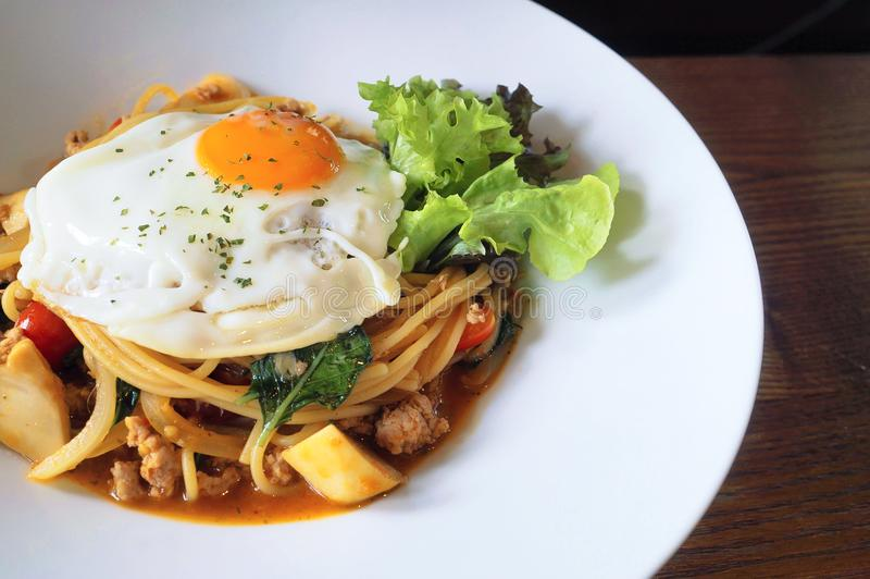 Delicious lunch, pasta with half-cooked egg and vegetables. stock images