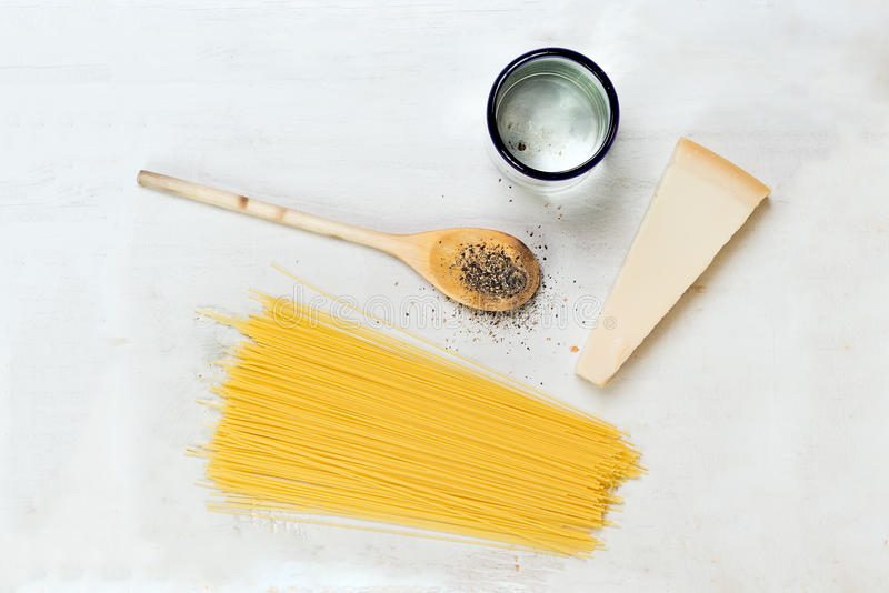 Pasta ingridients. View from above of board with pasta ingridients stock images