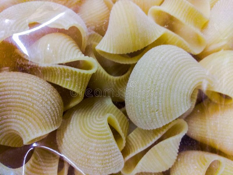 Pasta Italian food based on flour, eggs and water and available in different forms; it is usually cooked and served with a sauce o. R sauce stock photos
