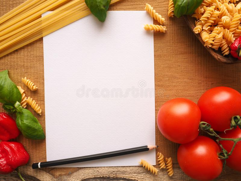Italian cooking ingredients on a wooden table royalty free stock photo