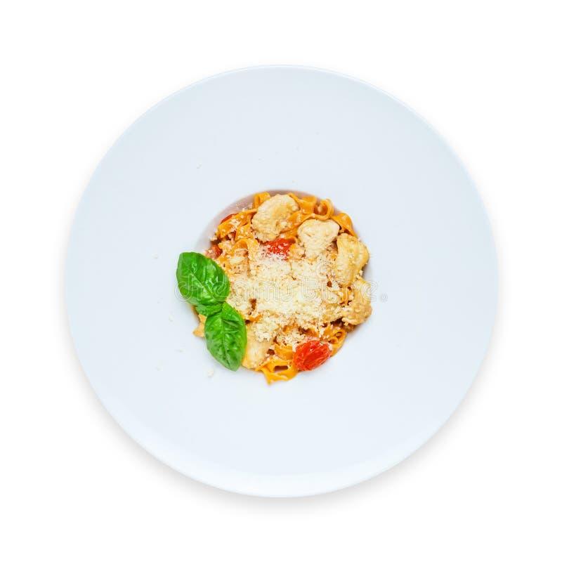 Pasta italiana tradizionale con il pomodoro curato fotografia stock libera da diritti