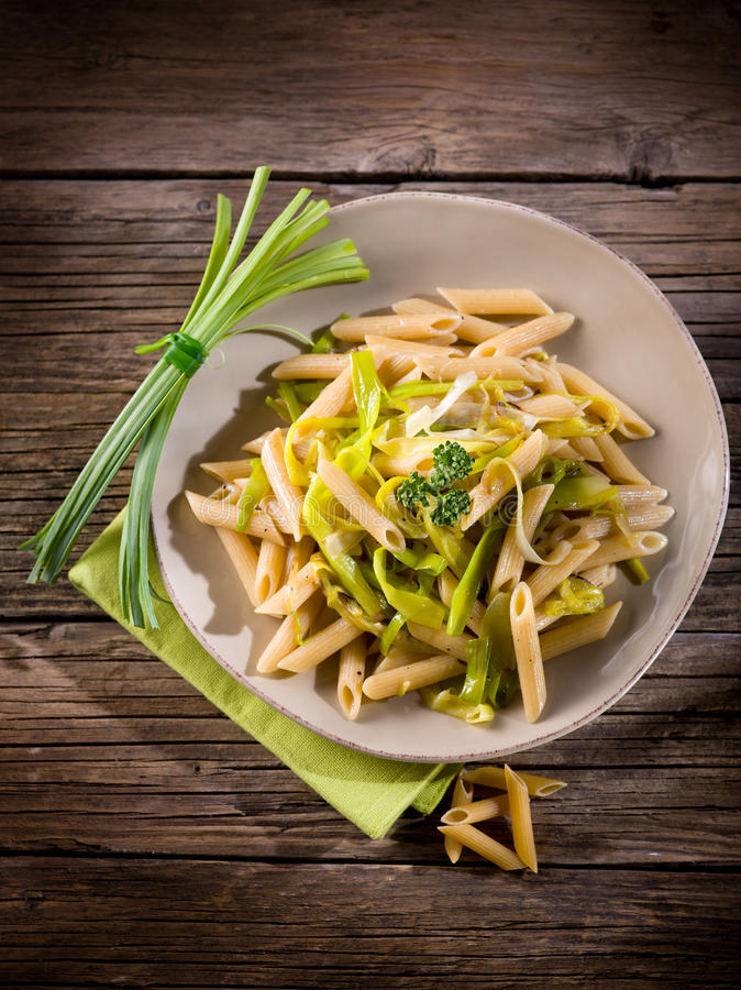 Pasta with leek and pepper. Healthy food stock image