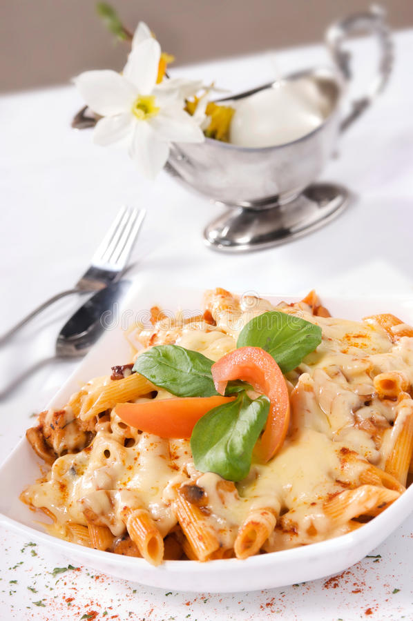 Pasta with meat and cheese sauce. stock photos