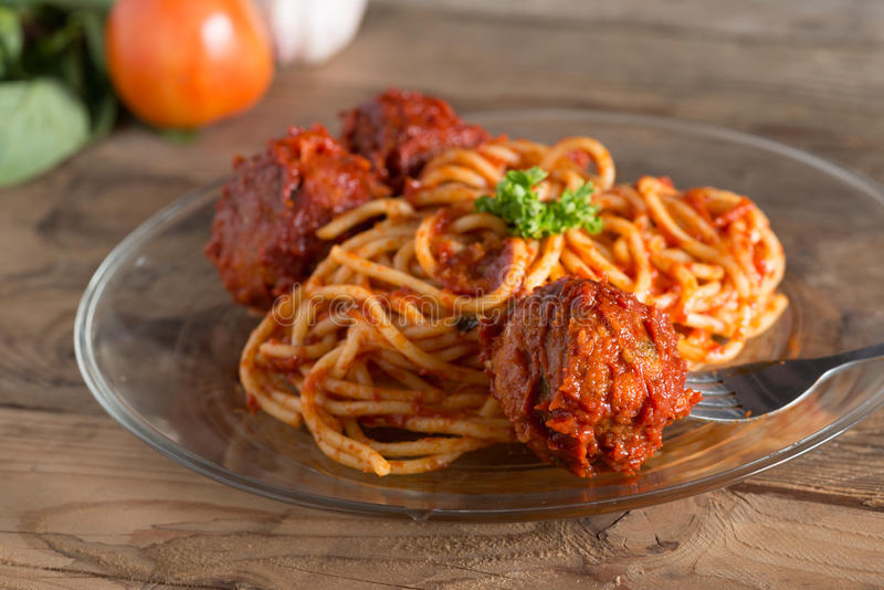 Pasta with meatballs and tomato sauce in glassware. Selective focus. stock photo
