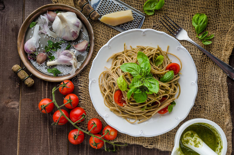 Pasta with Milan pesto. Basil with nuts and permesan, garlic and olive oil, delicious and genial food royalty free stock images