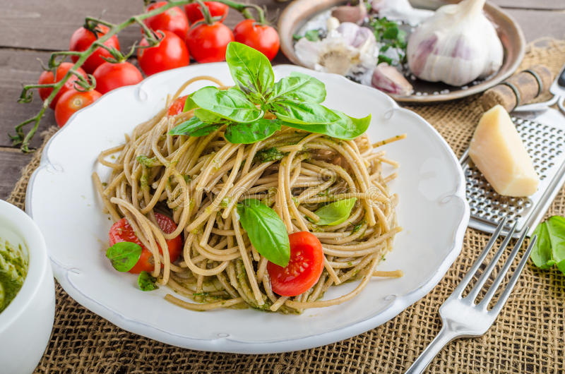 Pasta with Milan pesto. Basil with nuts and permesan, garlic and olive oil, delicious and genial food stock images