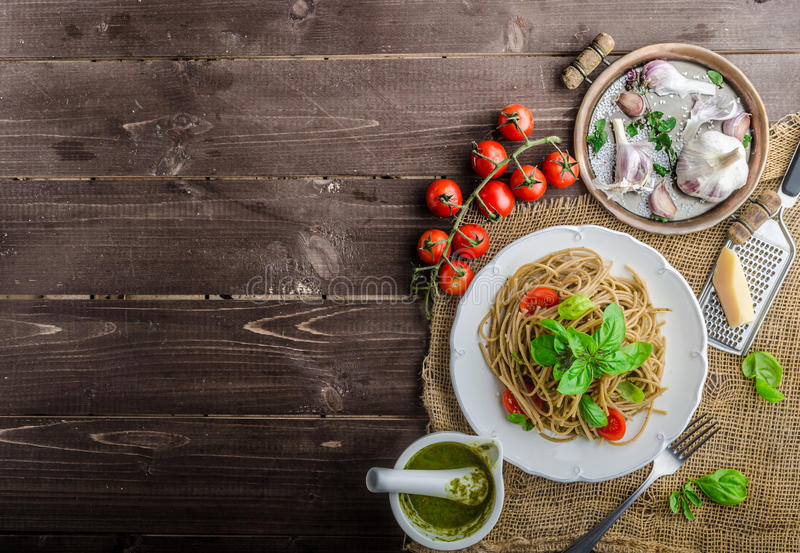 Pasta with Milan pesto. Basil with nuts and permesan, garlic and olive oil, delicious and genial food royalty free stock photography