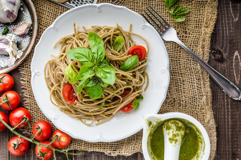 Pasta with Milan pesto. Basil with nuts and permesan, garlic and olive oil, delicious and genial food stock image