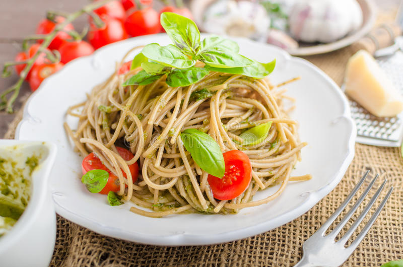Pasta with Milan pesto. Basil with nuts and permesan, garlic and olive oil, delicious and genial food stock photography
