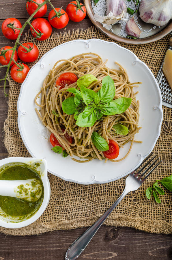 Pasta with Milan pesto. Basil with nuts and permesan, garlic and olive oil, delicious and genial food stock photo