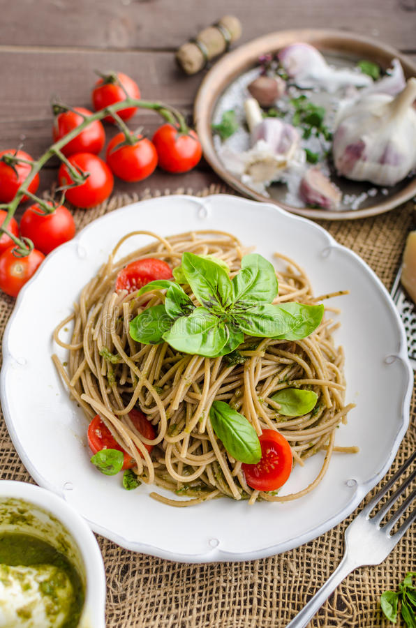 Pasta with Milan pesto. Basil with nuts and permesan, garlic and olive oil, delicious and genial food stock photos