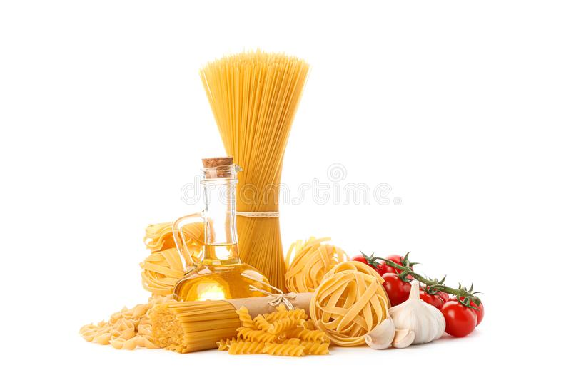 Pasta, olive oil, tomatoes and garlic isolated on white background stock photo
