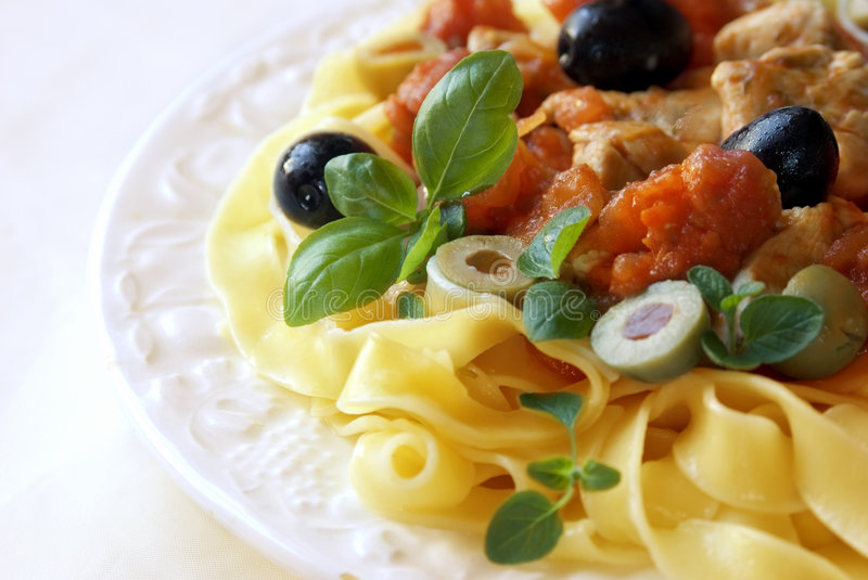 Pasta with olives and basil stock images
