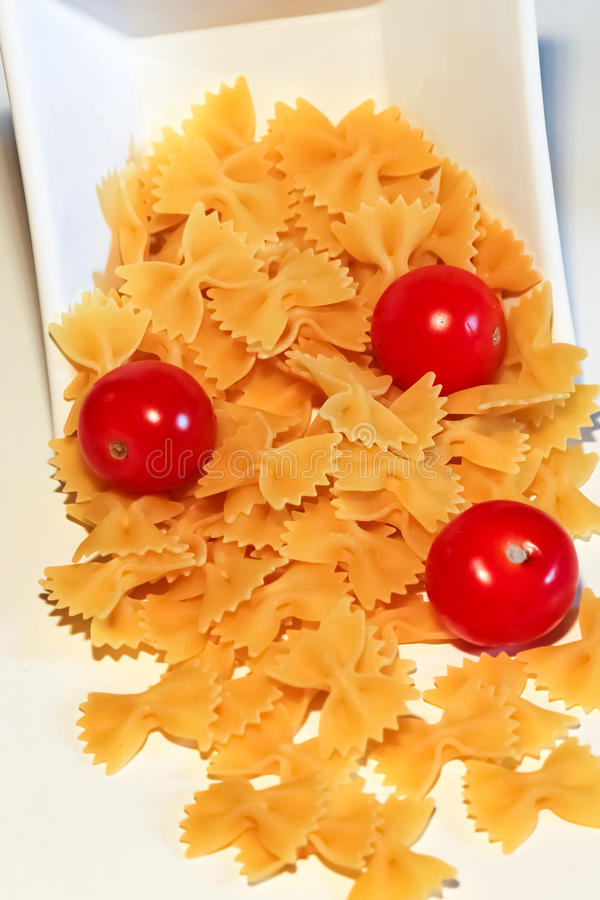 Pasta and pachino tomato royalty free stock images