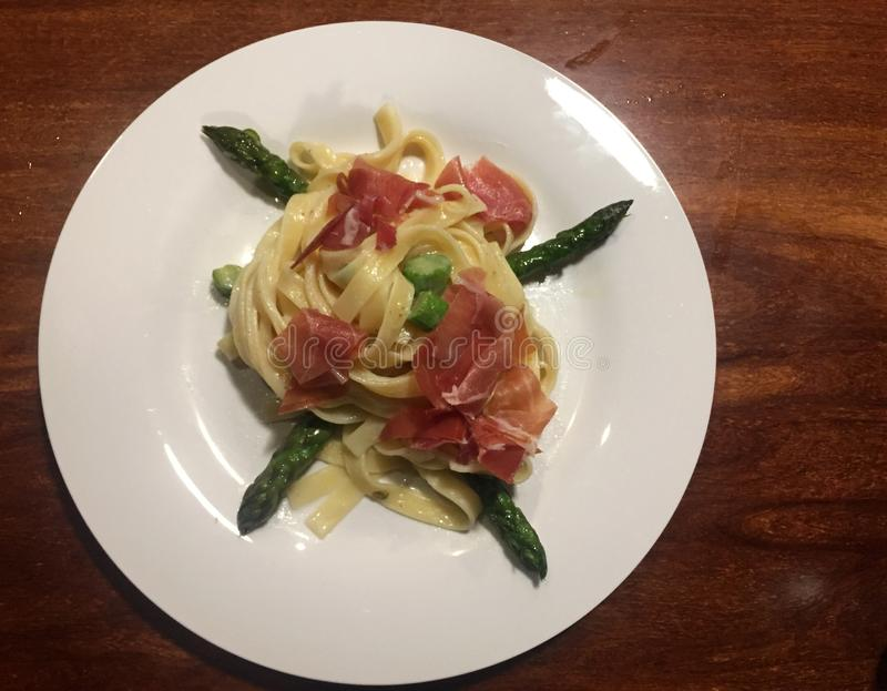 Pasta with Parma Ham. And Asparagus stock images