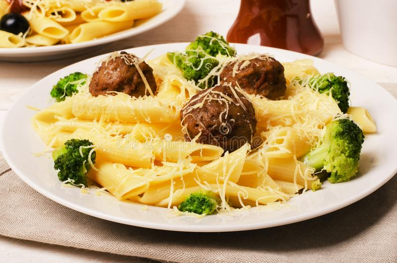 Pasta penne with meatballs stock photos