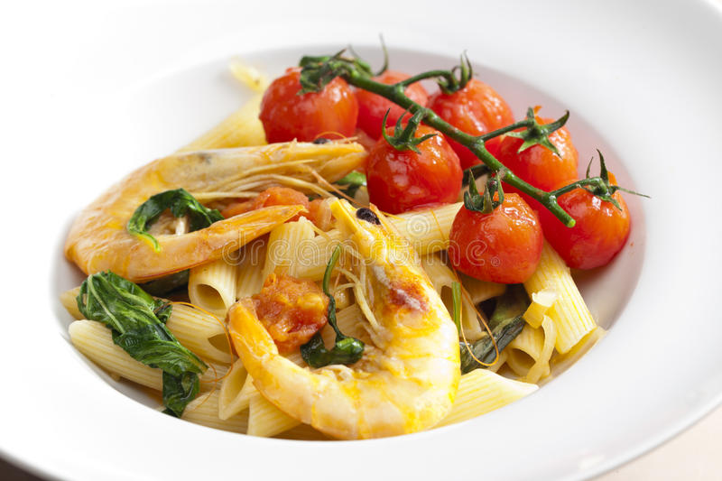 Pasta penne with prawns stock photography