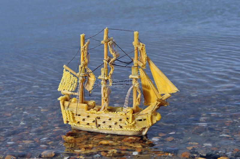 Pasta Pirate ship. Pirate ship made from pasta, sailing in the sea, it took 3 weeks to make, started with cardboard frame and then built with pasta shapes, an royalty free stock image