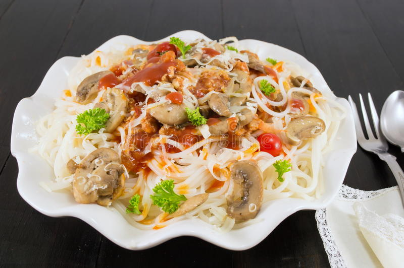 Pasta on a plate with mushrooms. And cherry tomatoes stock photo