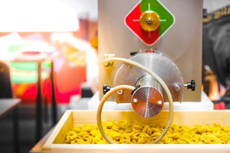 Pasta production line factory kneading machinery shape stock photos