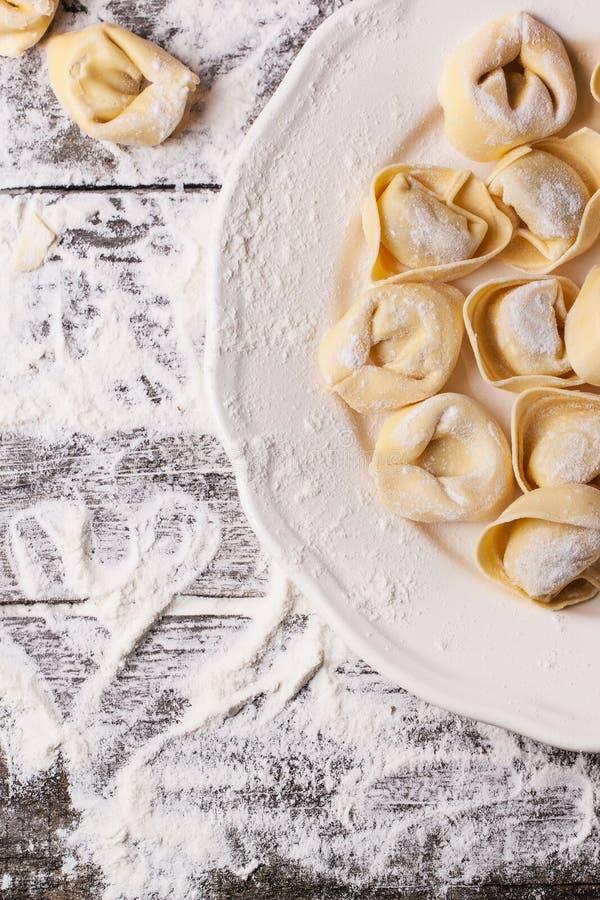 Pasta ravioli on flour royalty free stock photography