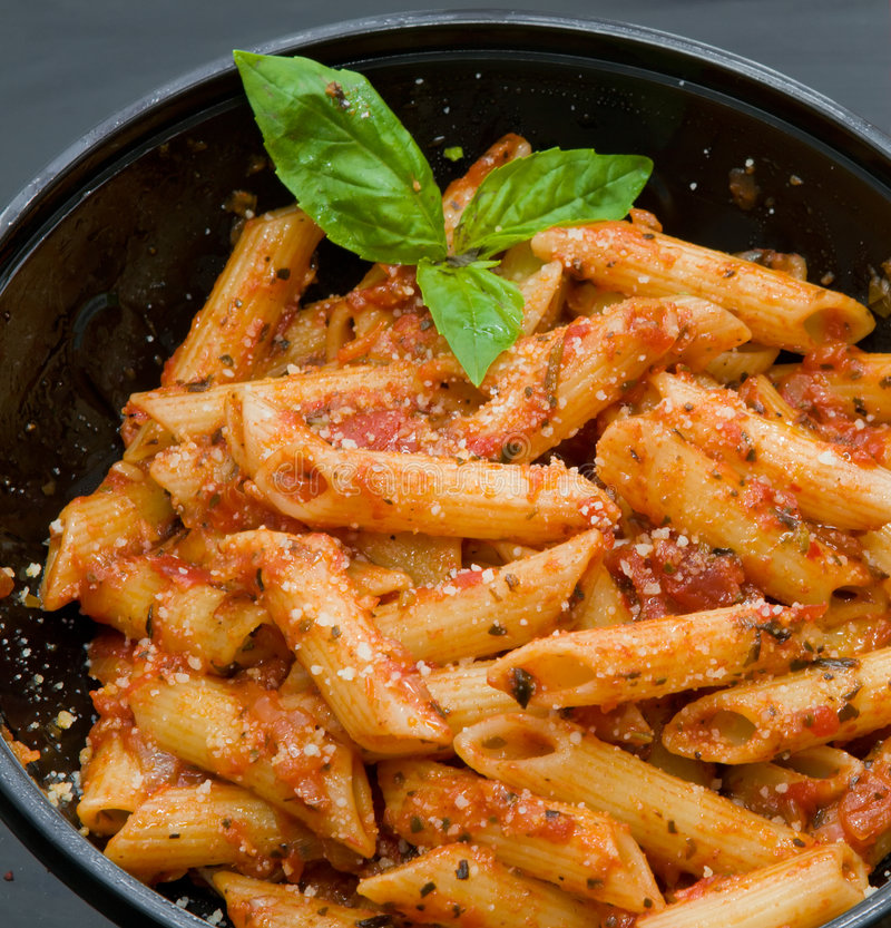 Pasta with red hot sauce royalty free stock photography