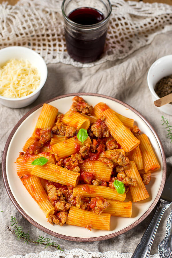 Pasta rigatoni in bolognese sauce with ground meat royalty free stock photos
