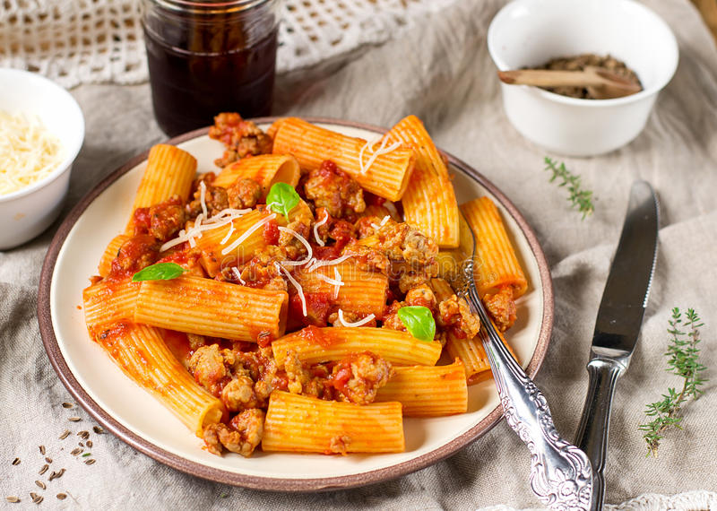 Pasta rigatoni in bolognese sauce with ground meat royalty free stock photography