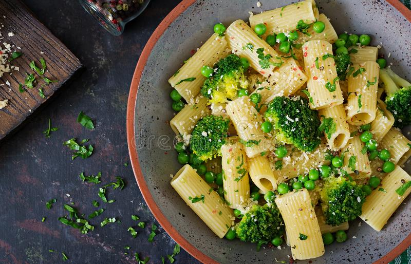 Pasta rigatoni with broccoli and green peas. Vegan menu. Dietary food. Flat lay. royalty free stock images