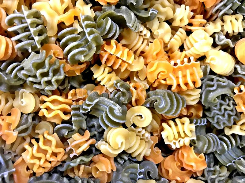 Pasta, Rotini, multi color, carrot, spinach, and regular. Pasta flavors, sold in bulk in Oklahoma City royalty free stock photo
