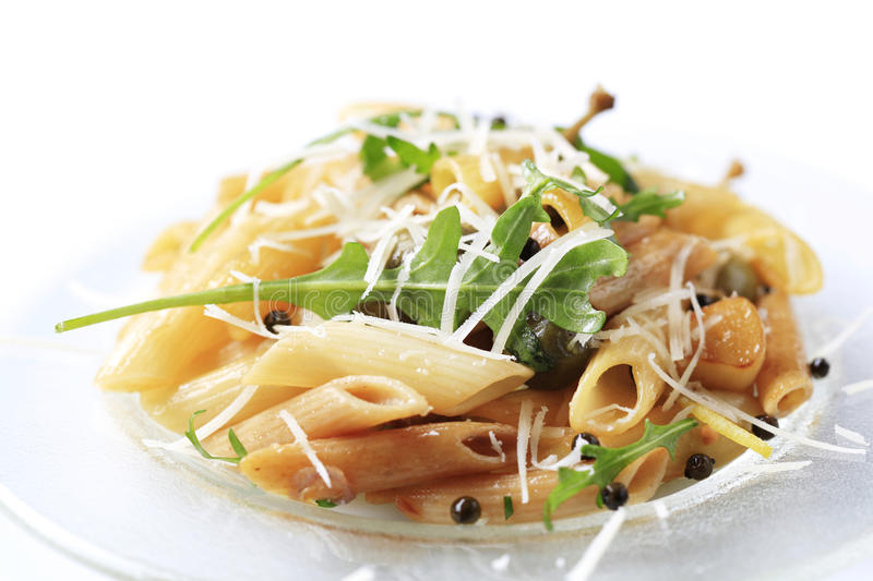 Pasta salad. Sprinkled with arugula and Parmesan royalty free stock photos