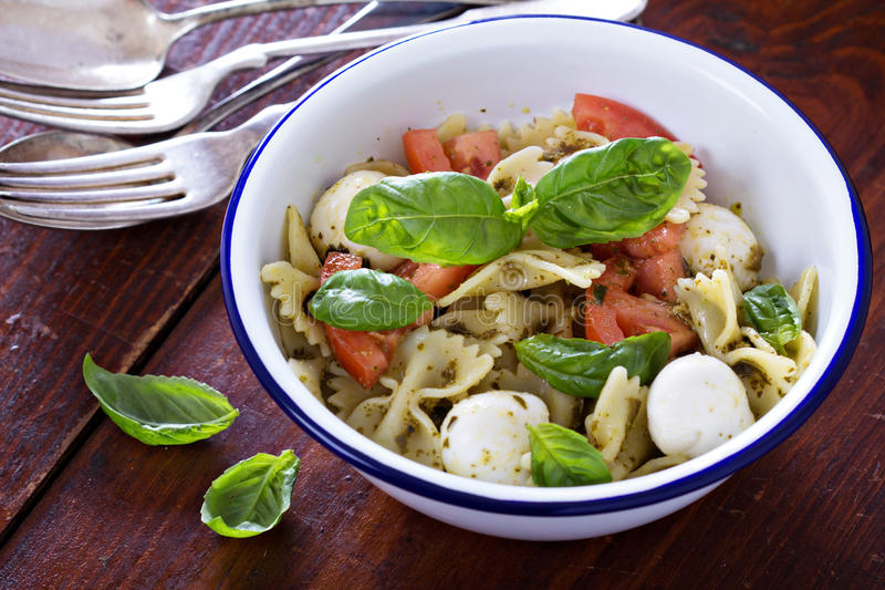 Pasta salad Caprese style with farfalle royalty free stock photography