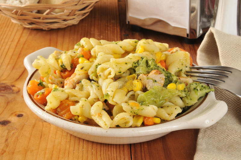 Pasta salad. With chicken, carrots, broccoli, and corn royalty free stock images