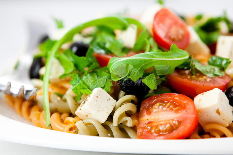 Pasta salad with feta. Cheese and vegetables stock photo