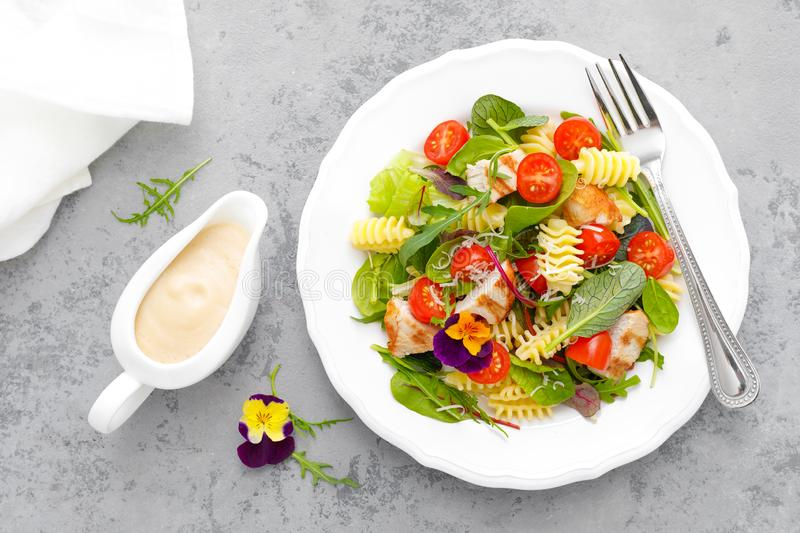 Pasta salad with grilled chicken meat, vegetables and cheese royalty free stock photos