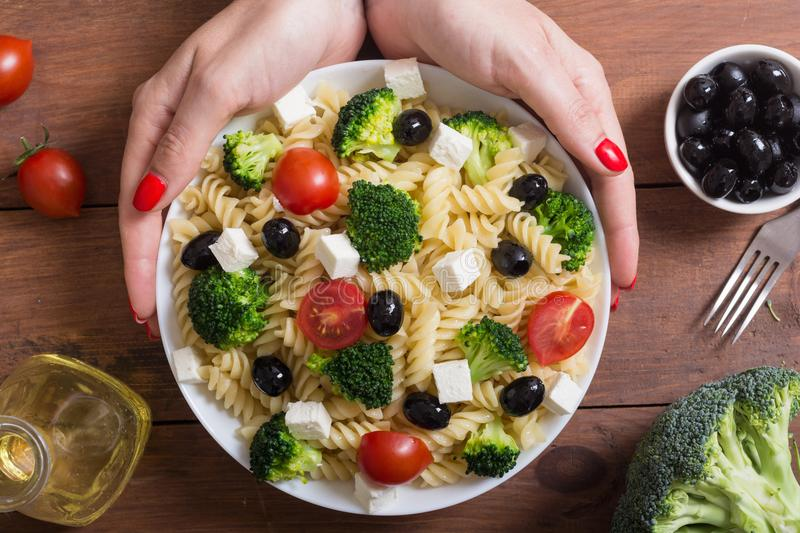 Pasta salad with ingridient. Broccoli , tomatoes , feta and olives royalty free stock photos