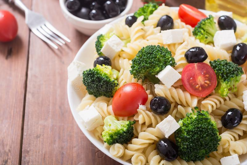 Pasta salad with ingridient. Broccoli , tomatoes , feta and olives stock photos
