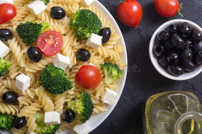 Pasta salad with ingridient. Broccoli , tomatoes , feta and olives royalty free stock images
