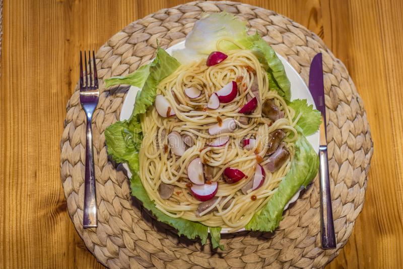 Pasta salad with meat and radishes. Low calorie food. royalty free stock photo