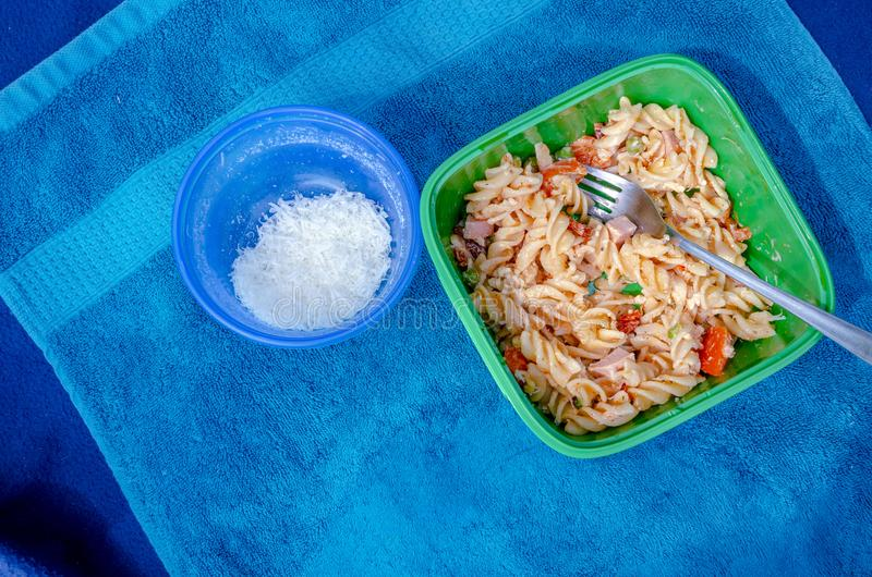 Pasta salad picnic on towel. Nice landscape of food vacation. Travel picture series royalty free stock image
