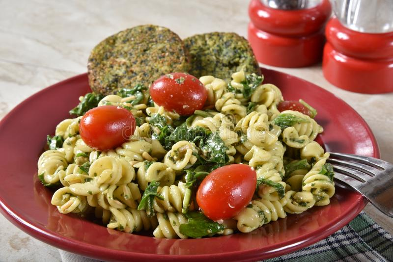 Pasta Salad and Spinach Cakes. Healthy spinach cakes with a spinach pasta salad stock images