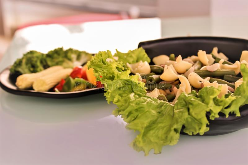 Pasta salad with veggies. Salad served with lots of veggies stock photo