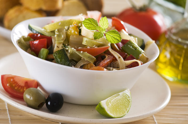 Pasta sald. Fresh pasta salad with tomato and roasted vegetables royalty free stock photography