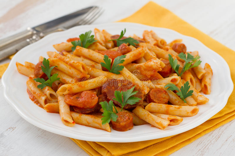 Pasta with sausages royalty free stock photo