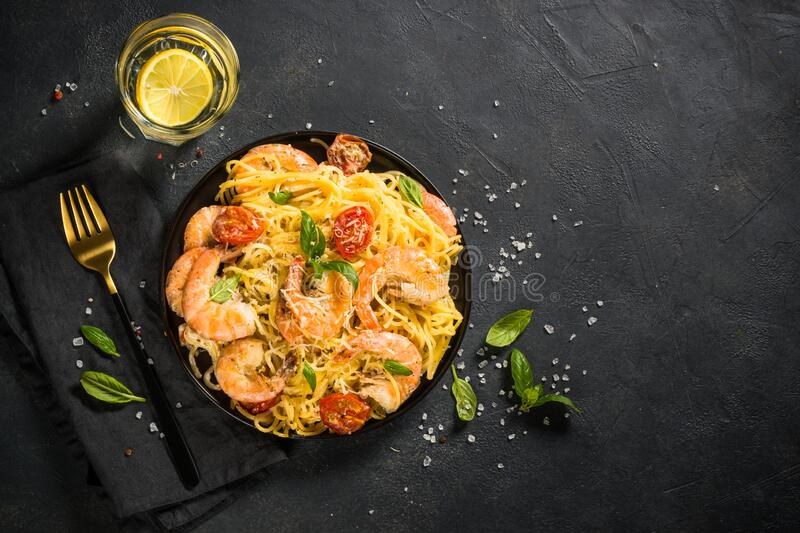 Pasta seafood with shrimp on black table. royalty free stock photos
