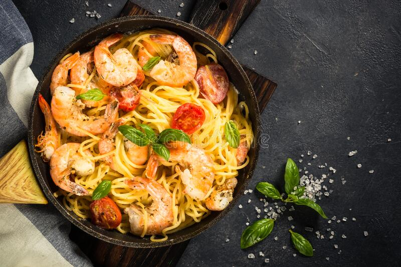 Pasta seafood with shrimp on black table. stock photography