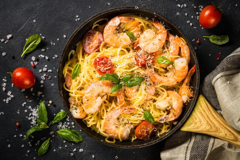 Pasta seafood with shrimp on black table. stock photos