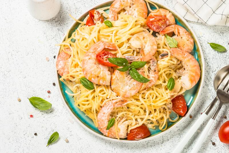 Pasta seafood with shrimp on white table. royalty free stock images